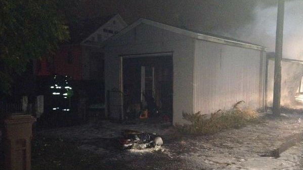 Spokane firefighters responded to a garage fire in north Spokane early Wednesday morning