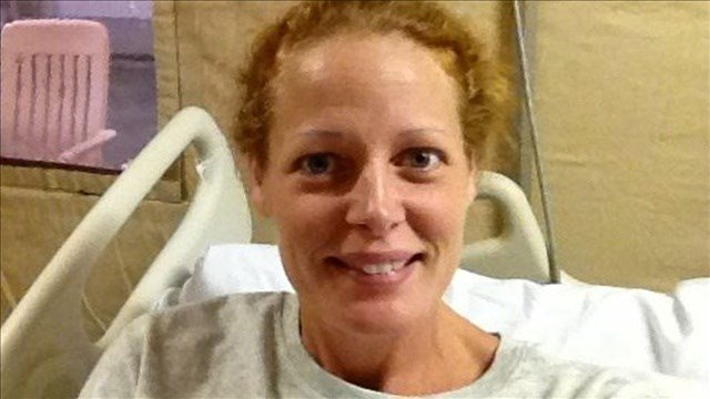 Kaci Hickox, stepped outside to meet briefly with reporters Wednesday night, followed through with her promise by leaving her home Thursday