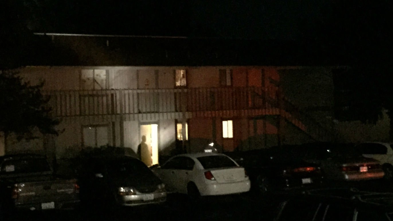 Detectives search the scene of a double homicide at the Broadway Square Apartments Saturday night