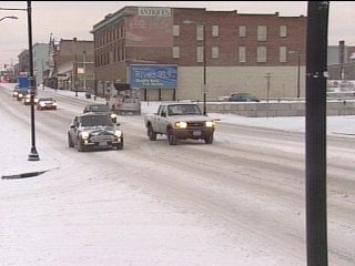 Drivers take it easy on snowy city streets Thursday morning in downtown Spokane.