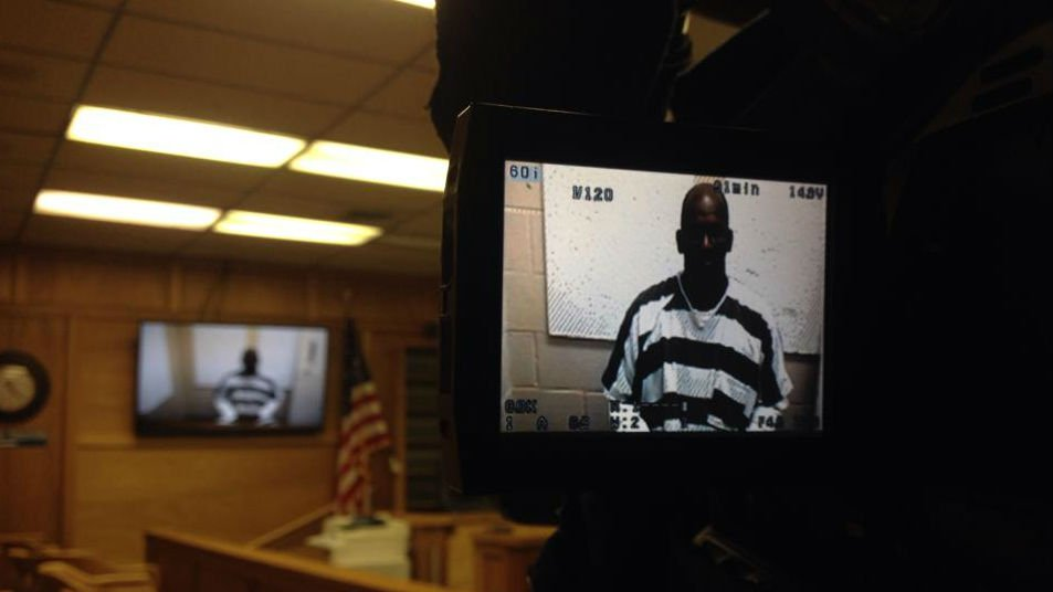 The wife of Basir Muhammad told KHQ she believes her husband is innocent. Muhammad made a court appearance in Clarkston on Monday.
