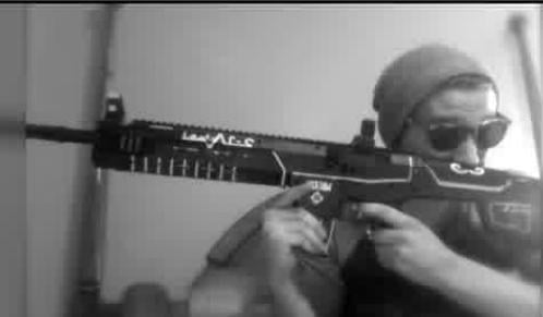Jake Merrick posts picture of himself holding an Airsoft Rifle