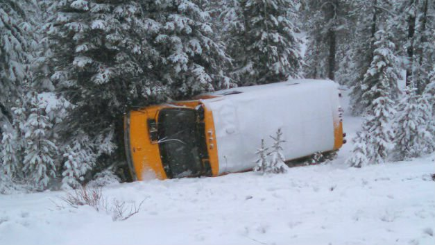 A bus carrying six students slid off an icy road west of Bend, Ore.
