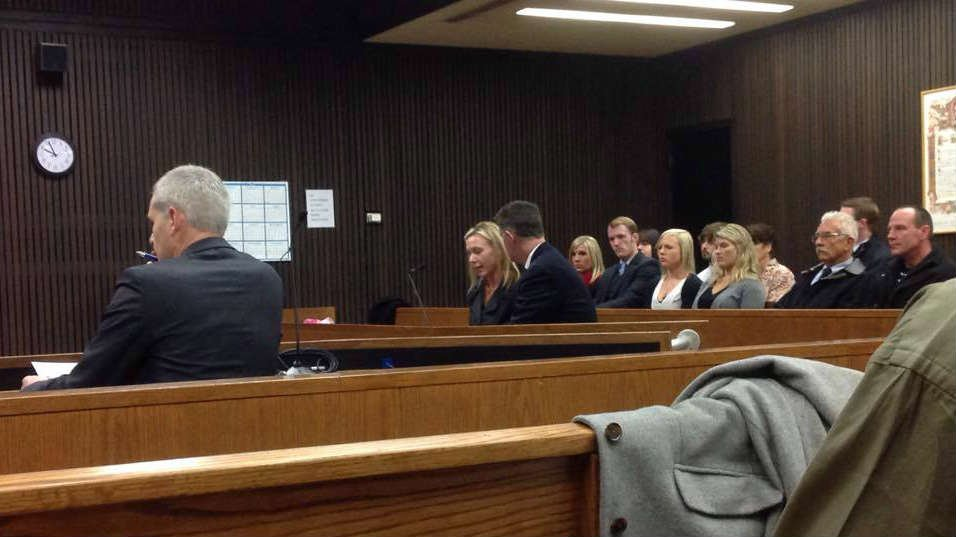 Marriya Wright (pictured center to the left of her attorney) pleaded guilty to Rendering Criminal Assistance to fugitive Matthew Baumrucker in March 2014.
