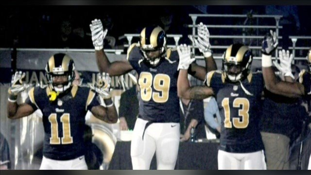 St. Louis Rams players display the 'Hands up, don't shoot' gesture while taking the field against the Oakland Raiders on Sunday (Photo: MSNBC / MGN )