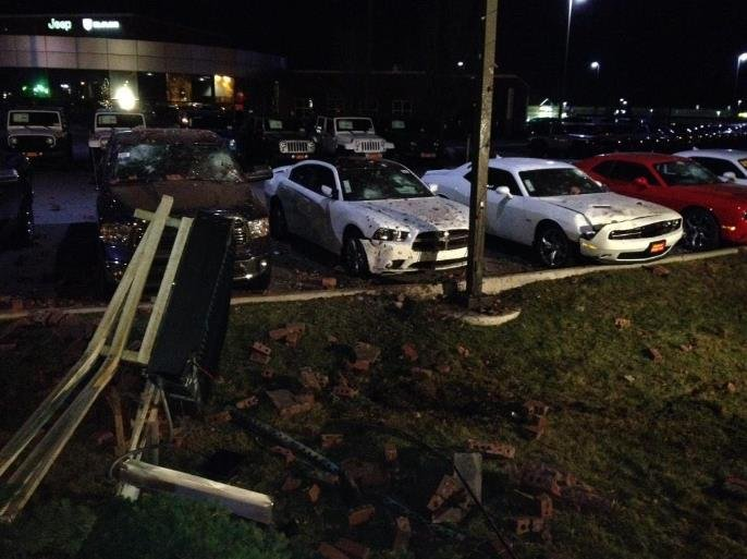Car crashes into front lawn of Dishman Dodge