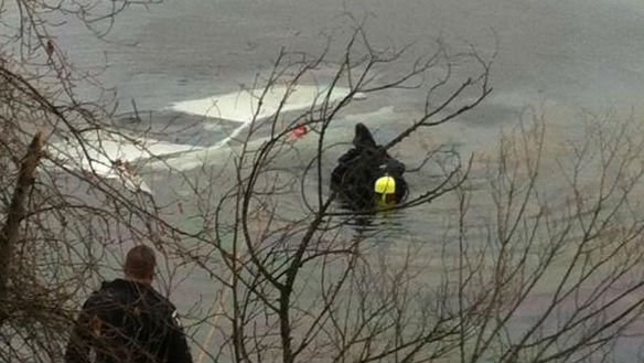 Kootenai County sheriff's deputies work to pull a car out of Coeur d'Alene Lake.