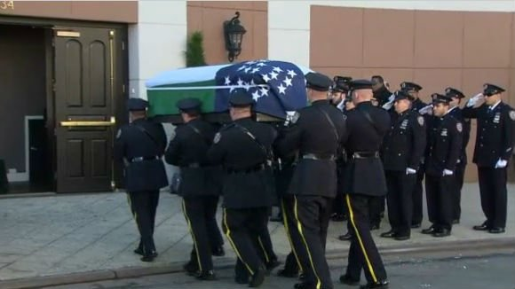 A scene from officer Ramos' wake on Friday.