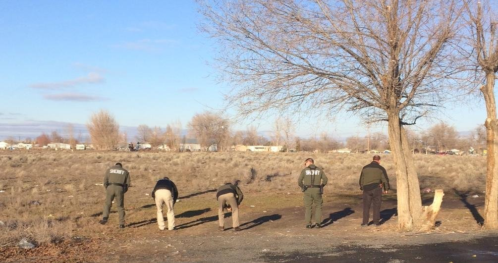Deputies search the area where the shooting happened Wednesday afternoon.