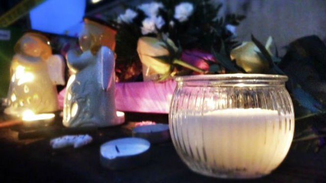 A vigil for the victims in Saturday's shooting in Moscow