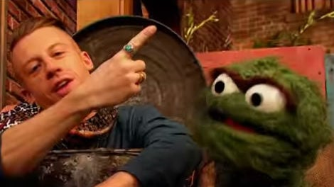 Oscar the Grouch and Macklemore rap about trash on Sesame Street. Photo: YouTube/Sesame Street