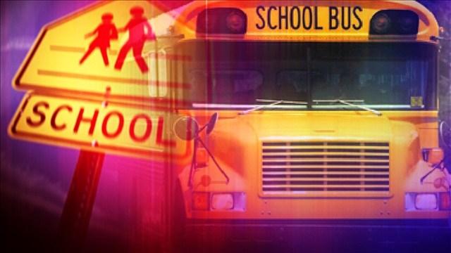 School bus overturns with 40 children in it.