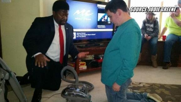 Kirby vacuum salesman Al Archie gives Dylan Johnson a demonstration on a Kirby vacuum for his 14th birthday. (PHOTO: Jodie Greene)
