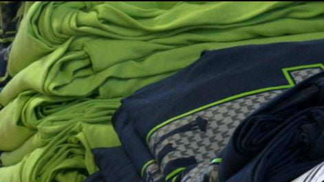 A local T-shirt screening company's Seahawks shirts are selling fast.
