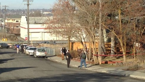Investigators at the scene of the homicide on Sunday afternoon.