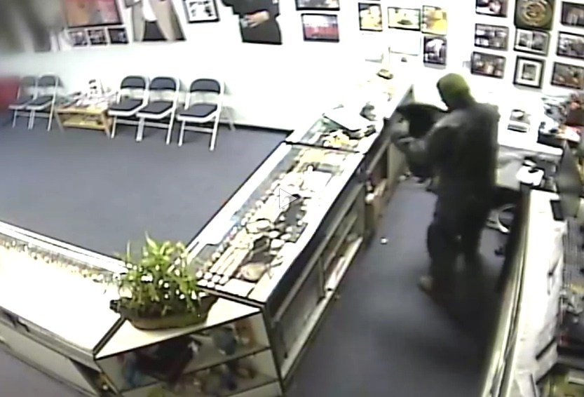 Investigators say the thief broke in through the roof and rappelled down into Marlene's Jewelry in Fresno around 4 a.m. Tuesday. (PHOTO CREDIT: youtube.com/thefresnobee)