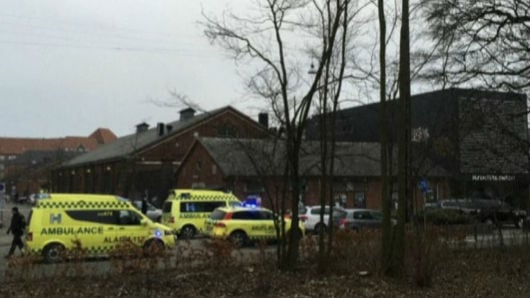 Police say three people have been wounded, including two police officers, in a shooting in downtown Copenhagen.