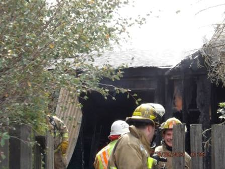 Shane Robins showing half of his trademark smile at a structure fire in the summer of 2013.