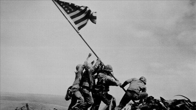 The flag raising on Mount Suribachi (PHOTO: Cropped Photo: Louis R. Lowery / MGN  )