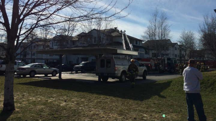 Firefighters on scene of an apartment fire in Spokane Valley