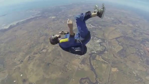 This skydiver is having a seizure in midair. Photo: YouTube/Nomadic Adrenaline