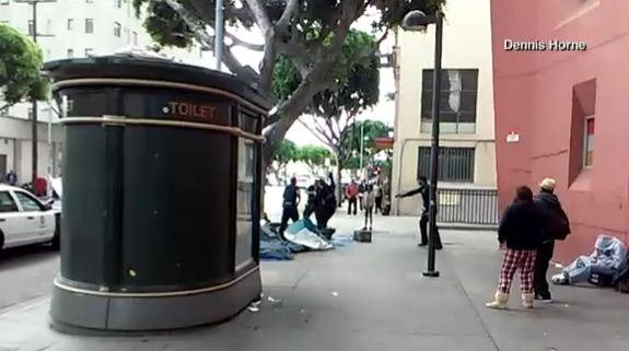 Cell phone video shows the confrontation and shooting between a man and several LAPD officers. (PHOTO/VIDEO: Dennis Horne)