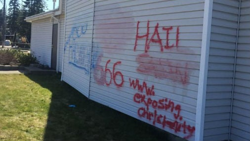 Vandals spray painted the back of a church in Spokane Valley.