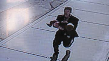 The suspect seen with the boy in his arms just after the attempted abduction.