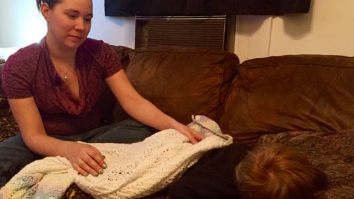Nicole Wright with her son, who was nearly abducted on Sunday.