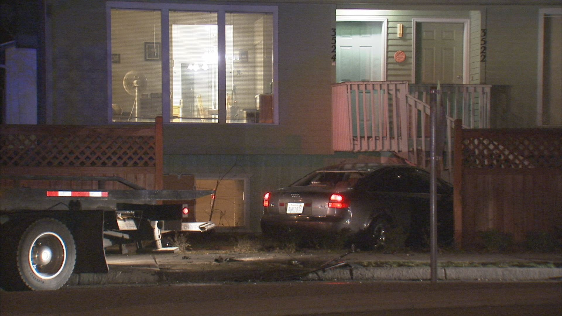 A car crashed into a house after a short pursuit on the lower south hill early Tuesday morning