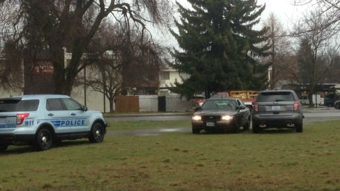 Police outside the Manor Vale Apartment complex in Spokane Valley.