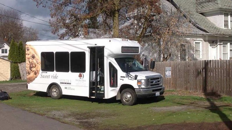 Spokane Police arrested a man who they say stole a shuttle bus from the Double Tree Inn Monday morning.