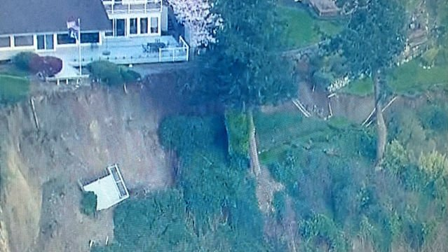 A South King Fire and Rescue official says a landslide has damaged four homes in the south Seattle suburb of Des Moines.