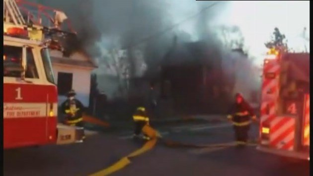 Spokane Firefighters battling three separate house fires at the same time Sunday morning near E. 5th and S. Chandler