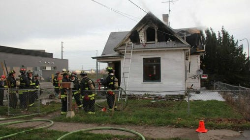 Spokane firefighters and police are investigating the large fire that damaged three homes early Sunday morning.