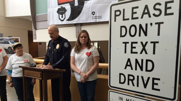 Law enforcement from around Eastern Washington gathered Wednesday to announce enhanced distracted driving patrols and unveil a sign in memory of an 18-year-old killed in an ugly crash last September.