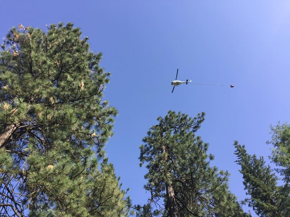 Planes bring in water from the Spokane River to the Indian Canyon fire