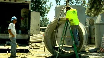 Spokane workers hard at work despite the heat.