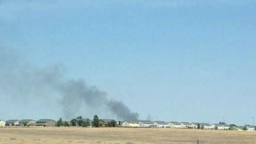 Smoke from an apparent mobile home park fire in Moses Lake