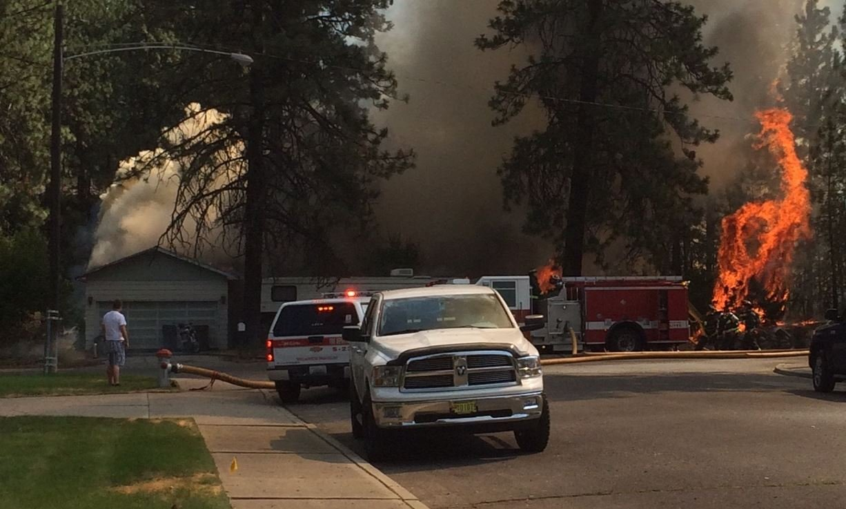 While Spokane firefighters battled this fire in northwest Spokane, many others were out battling wildfires in Washington and Idaho