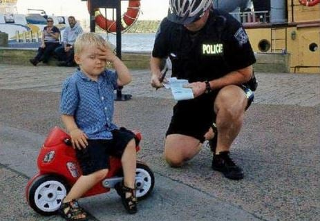 Declan Tramley received a parking ticket in Canada from a Halifax Police officer for illegally parking his plastic red motorcycle. All he could think to do, was face-palm.