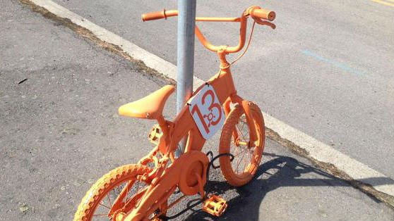 These orange bikes are used to advertise a new gym.