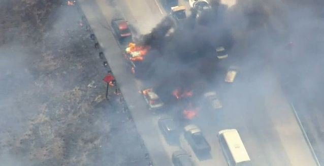 The scene as a wildfire swept across a highway Friday.