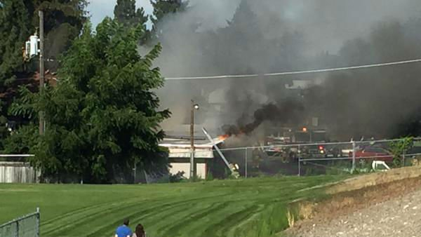 Spokane Valley fire destroys line of garages, damages ...