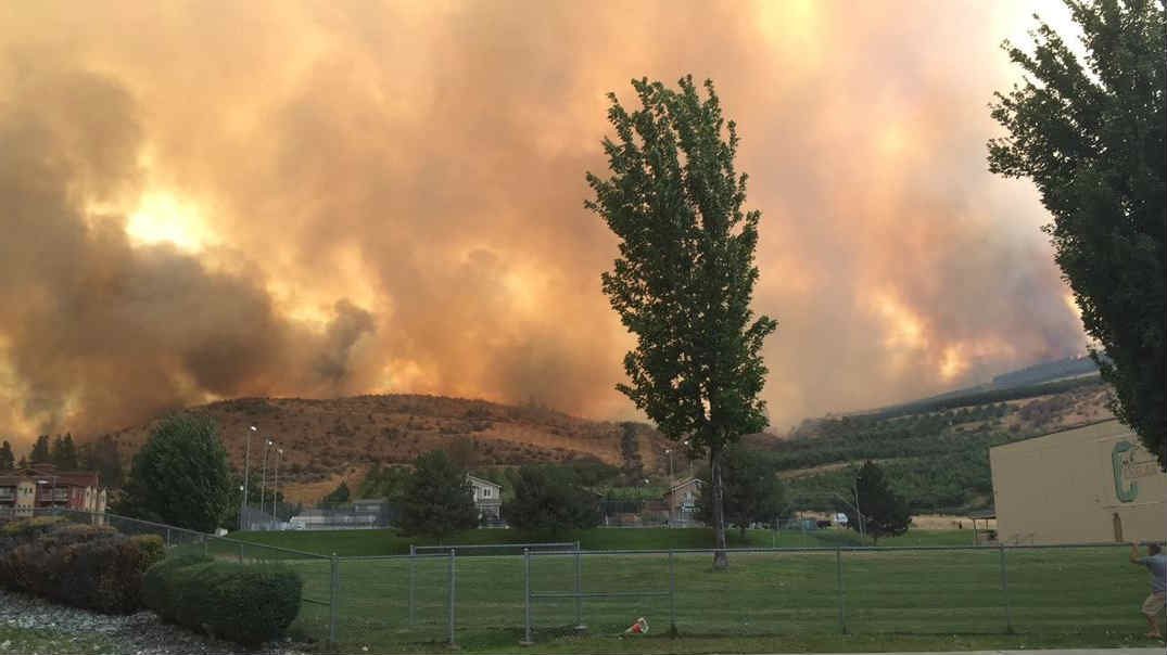 Fire approaches Chelan High School on Friday.