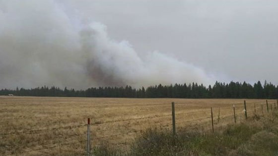 Smoke from a fire burning near Athol. Photo: Adam Sperry