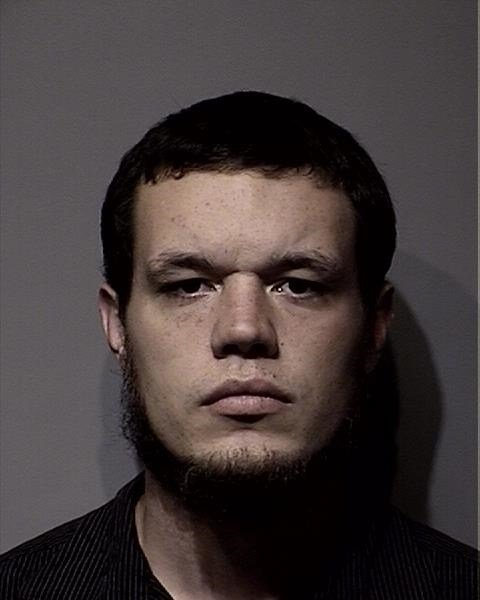 Booking photo for 27-year-old Christopher Nelson