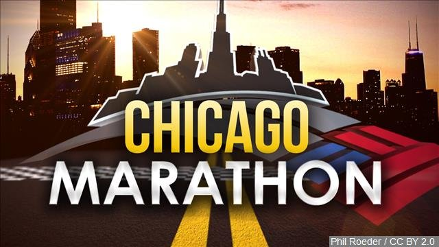 A man running in the Chicago Marathon has been revived by a paramedic after suffering an apparent heart attack.