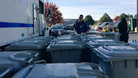 Employees at STCU and Shred It are helping to shred your sensitive documents