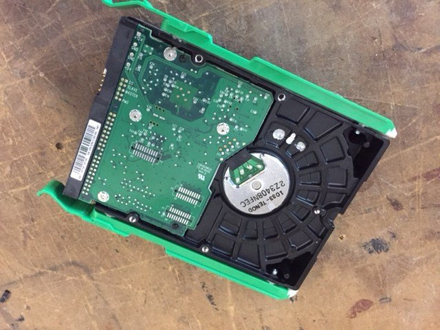 The best way to get rid of a hard drive is to digitally wipe it clean and then drill it.